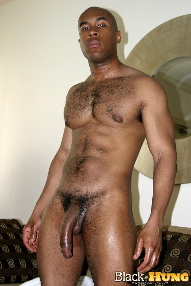 Black stud jerks off cock and cums
