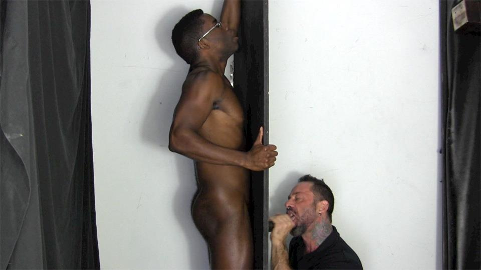 Big black rod sticking out of glory hole gets sucked